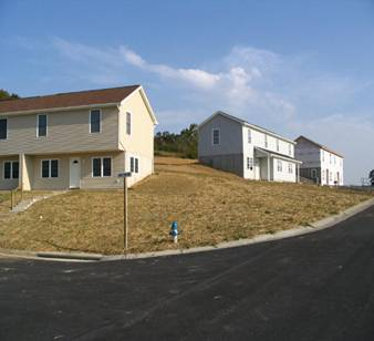 New duplexes rise on Joppa Court in the Hope Community Builders' Covenant Heights subdivision, Rt. 11 South, behind the Division of Motor Vehicles.